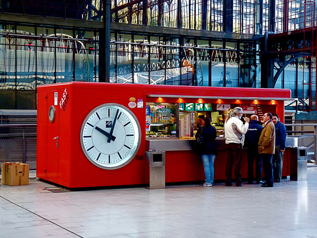 A Quick Snack! Fast Bar Clock in the Principe Pío Station in Madrid Spain