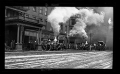 Fire trucks outside the Powers Fire Proof Hotel in Rochester, New York c1890s