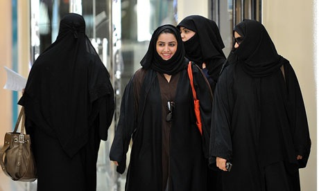 Saudi women walk inside the Faysalia shopping centre in Riyadh